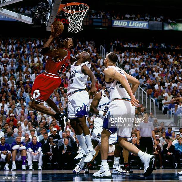 Scottie Pippen of the Chicago Bulls attmpts a layup against Bryon Russell of the Utah Jazz in Game One of the 1998 NBA Finals at the Delta Center on...