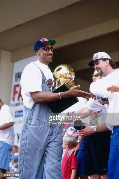 Scottie Pippen of the Chicago Bulls celebrates at the Bulls 1996 NBA Championship parade on June 18 1996 in Chicago Illinois NOTE TO USER User...