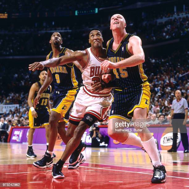 Scottie Pippen of the Chicago Bulls defends Rik Smits of the Indiana Pacers during a game played on May 31 1998 at the United Center in Chicago...