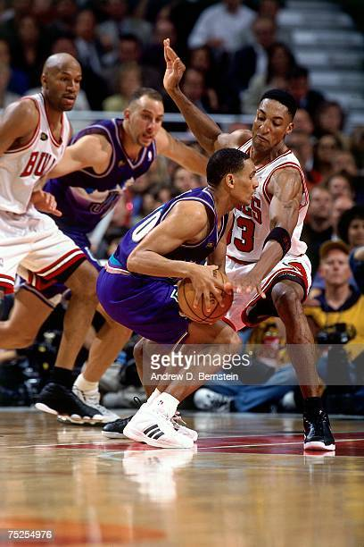 Scottie Pippen of the Chicago Bulls digs in on defense against Shandon Anderson of the Utah Jazz in Game Four of the 1998 NBA Finals at the United...