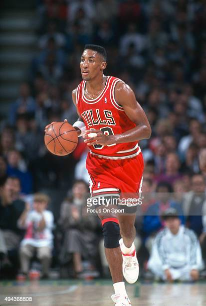 Scottie Pippen of the Chicago Bulls dribbles the ball against the Milwaukee Bucks during an NBA basketball game circa 1990 at the Bradley Center in...