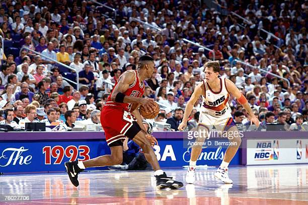 Scottie Pippen of the Chicago Bulls dribbles upcourt against Danny Ainge of the Phoenix Suns in Game Two of the 1993 NBA Finals on June 11 1993 at...