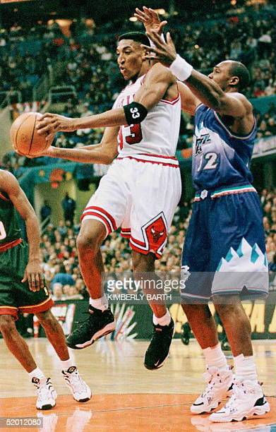 Scottie Pippen of the Chicago Bulls drives past Karl Malone of the Utah Jazz during the first half of the NBA AllStar Game 09 February at Gund Arena...