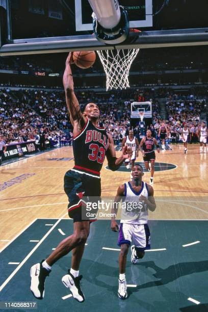 Scottie Pippen of the Chicago Bulls drives to the basket during the game against Terrell Brandon of the Milwaukee Bucks on January 16 1998 at the BMO...