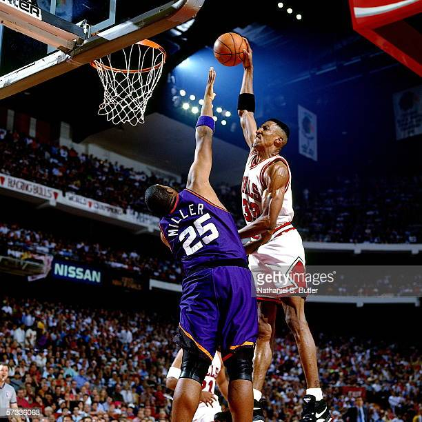 Scottie Pippen of the Chicago Bulls dunks against Oliver Miller of the Phoenix Suns during Game Three of the NBA Finals at the United Center on June...