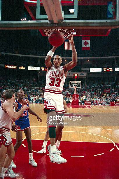 Scottie Pippen of the Chicago Bulls dunks against the Phoenix Suns during a game played on March 26 1990 at Chicago Stadium in Chicago Illinois NOTE...