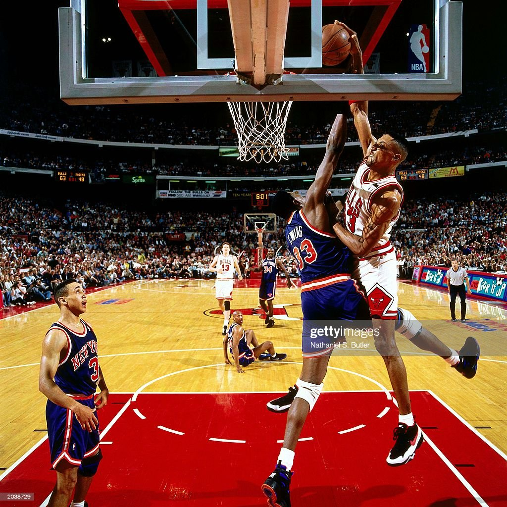 Scottie Pippen #33 of the Chicago Bulls goes for a dunk over Patrick Ewing #33 of the New York Knicks in Game six of the Eastern Conference Semifinals during the 1994 NBA Playoffs at Chicago Stadium in Chicago, Illinios.