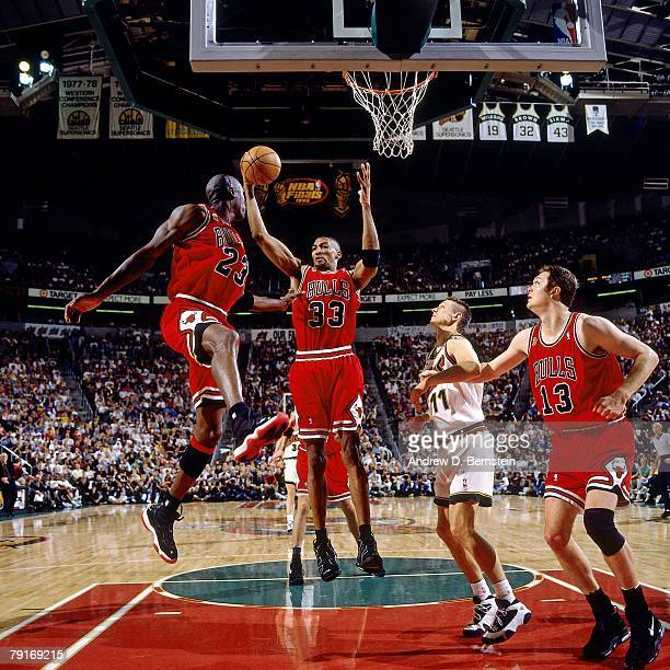 Scottie Pippen of the Chicago Bulls grabs a rebound against Detlef Schrempf of the Seattle SuperSonics in Game Three of the 1996 NBA Finals at Key...