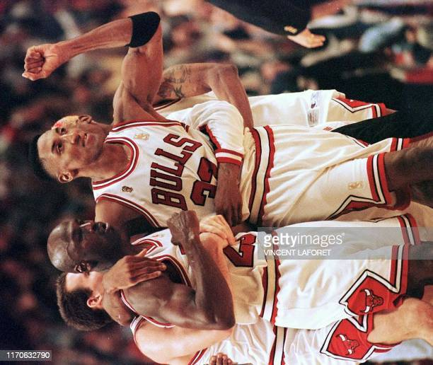 Scottie Pippen of the Chicago Bulls hugs teammate Michael Jordan after Jordan hit the gamewinning shot against the Utah Jazz 01 June during the...