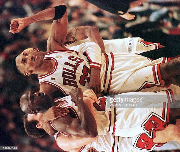 Scottie Pippen of the Chicago Bulls hugs teammate Michael Jordan after Jordan hit the game-winning shot against the Utah Jazz 01 June during the...