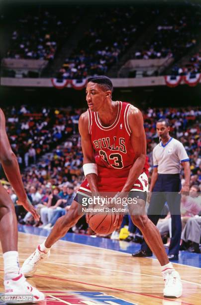 Scottie Pippen of the Chicago Bulls looks to shoot against the New Jersey Nets circa 1990 at the Brendan Byrne Arena in East Rutherford New Jersey...
