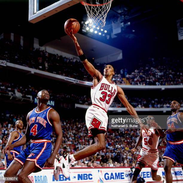 Scottie Pippen of the Chicago Bulls shoots a layup against Anthony Bonner of the New York Knicks at United Center on April 24 1994 in Chicago...