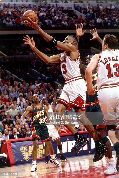 Scottie Pippen of the Chicago Bulls shoots a layup during Game Six of the 1996 NBA Finals against the Seattle SuperSonics at the United Center on...