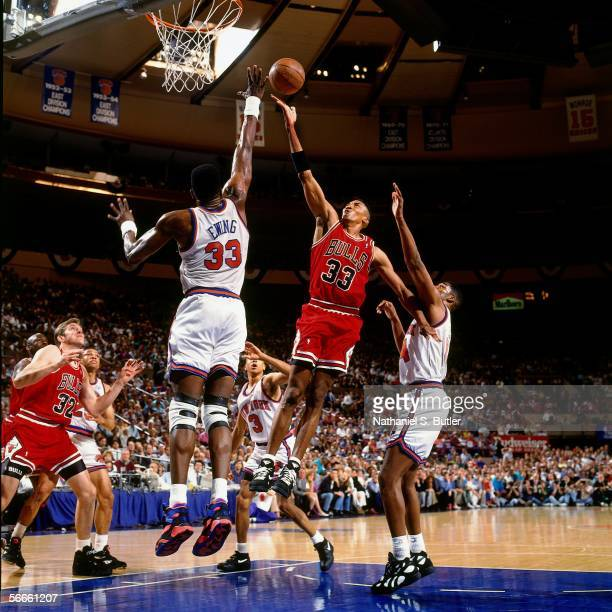 Scottie Pippen of the Chicago Bulls shoots against Patrick Ewing of the New York Knicks during Game 5 of the Eastern Conference Finals June 2 1993 at...