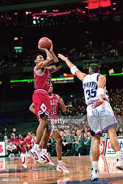 Scottie Pippen of the Chicago Bulls shoots against the Toronto Raptors on January 18 1996 at SkyDome in Toronto Canada NOTE TO USER User expressly...