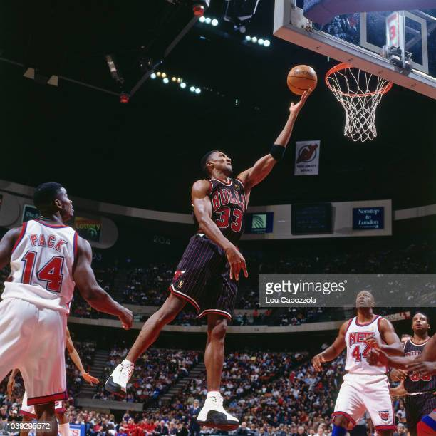 Scottie Pippen of the Chicago Bulls shoots the ball during the game against the New Jersey Nets on December 13 1996 at the Continental Airlines Arena...