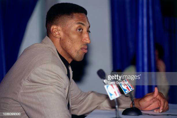 Scottie Pippen of the Chicago Bulls talks with media at the post game interview after the game against the Utah Jazz on June 8 1997 at the Delta...