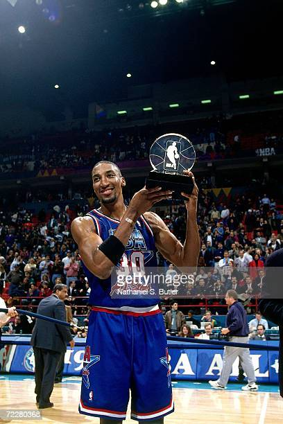 Scottie Pippen of the Eastern Conference All Stars poses with the MVP trophy following the 1994 NBA All Star Game played on February 13 1994 at the...