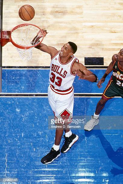 Scottie Pippen of the Eastern Conference shoots against Gary Payton of the Western Conference during the 1997 AllStar Game on February 9 1997 at Gund...
