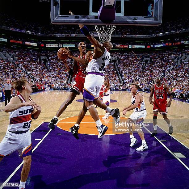 Scottie Pippen of the Phoenix Suns takes the ball to the basket against Charles Barkley of the Phoenix Suns during Game one of the 1993 NBA Finals...