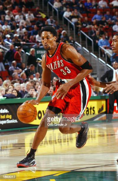 Scottie Pippen of the Portland Trail Blazers drives against the Seattle Sonics during the game at Key Arena on March 11 2003 in Seattle Washington...
