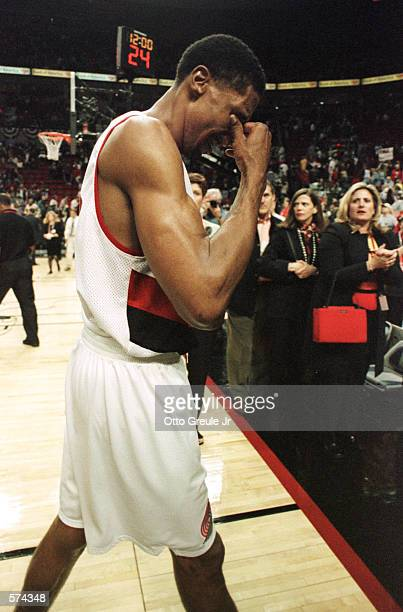 Scottie Pippen of the Portland Trail Blazers walks dejectedly off the court after the Los Angeles Lakers defeated the Blazers 9986 in game 3 of the...