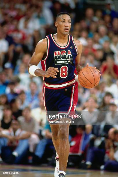 Scottie Pippen of the United States Senior Men's National Basketball Team brings the ball up court during the Basketball Tournament of Americas circa...