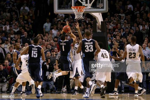 Scottie Reynolds of the Villanova Wildcats puts up the game-winning shot against the Pittsburgh Panthersduring the NCAA Men's Basketball Tournament...