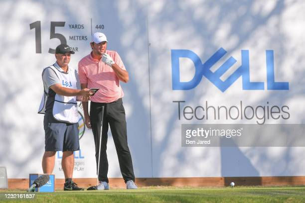 Scottie Scheffler and his caddie stand together on the 15th tee box during the championship match at the World Golf Championships-Dell Technologies...
