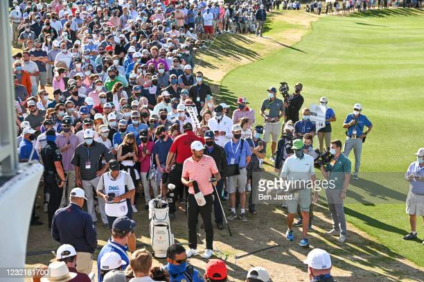 Scottie Scheffler gets ready for his next shot near the 13th hole during the championship match at the World Golf Championships-Dell Technologies...