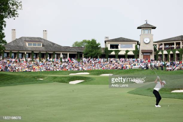 Scottie Scheffler of the United States plays a shot on the 18th hole during the final round of The Memorial Tournament at Muirfield Village Golf Club...