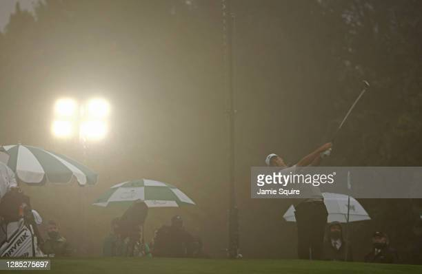 Scottie Scheffler of the United States plays a shot on the range prior to the first round of the Masters at Augusta National Golf Club on November...