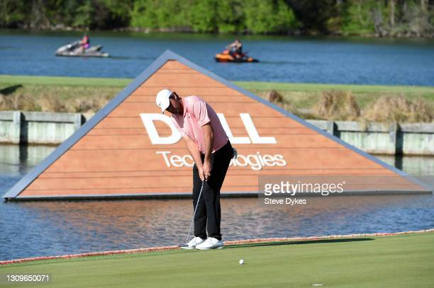 Scottie Scheffler of the United States putts on the 13th hole in his match against Billy Horschel of the United States during the final round of the...