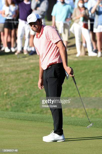 Scottie Scheffler of the United States putts on the 16th hole in his match against Billy Horschel of the United States during the final round of the...