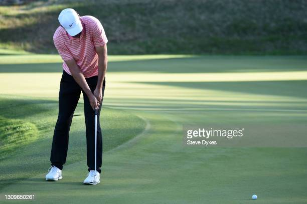 Scottie Scheffler of the United States putts on the 17th green in his match against Billy Horschel of the United States during the final round of the...