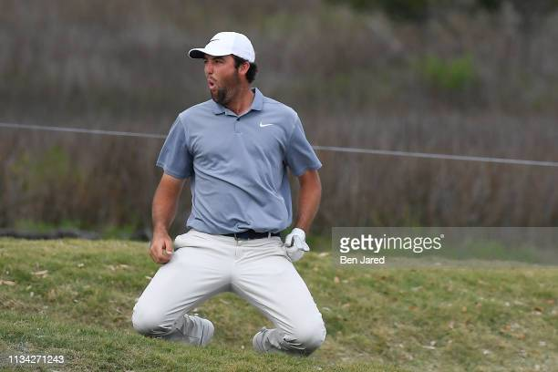 Scottie Scheffler reacts to a close eagle opportunity on the eighteenth hole green that would have given him the lead during the final round of the...