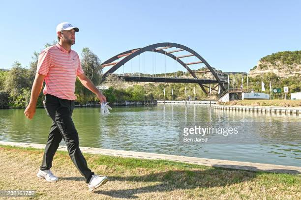 Scottie Scheffler walks towards the 13th tee box during the championship match at the World Golf Championships-Dell Technologies Match Play at Austin...