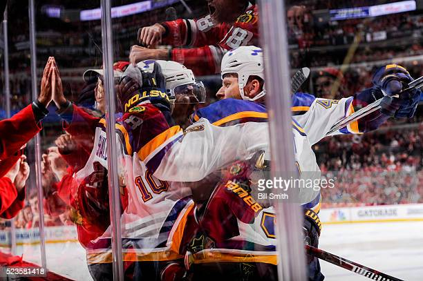 Scottie Upshall and Steve Ott of the St Louis Blues react after Upshall scored against the Chicago Blackhawks in the first period of Game Six of the...