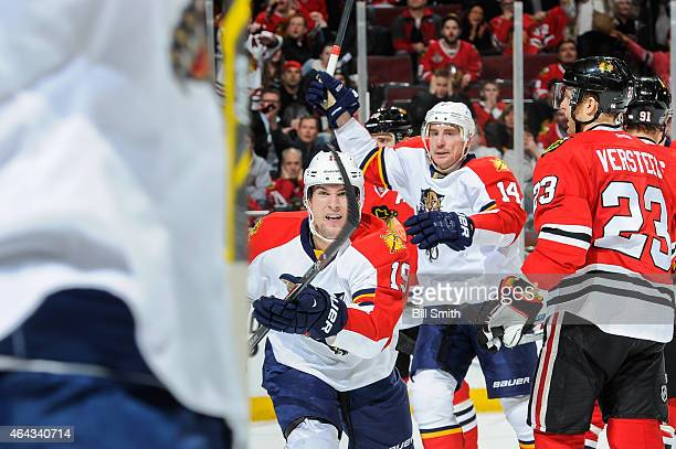 Scottie Upshall and Tomas Fleischmann of the Florida Panthers react after teammate Trocheck scored in the third period to tie the game against the...