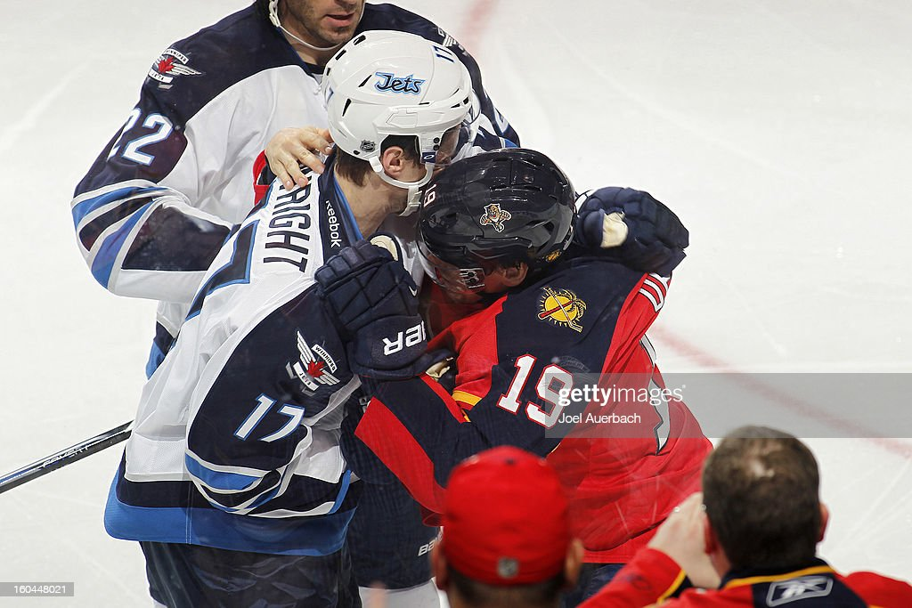 Scottie Upshall #19 of the Florida Panthers and James Wright #17 of the Winnipeg Jets fight during third period action at the BB&T Center on January 31, 2013 in Sunrise, Florida. The Panthers defeated the Jets 6-3.
