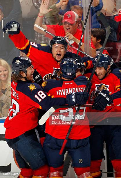 Scottie Upshall of the Florida Panthers celebrates his goal with teammates against the New Jersey Devils in Game Five of the Eastern Conference...