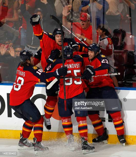Scottie Upshall of the Florida Panthers celebrates with Tyson Strachan Ed Jovanovski and Shawn Matthias after scoring a third period goal against the...