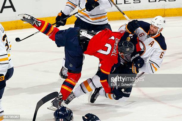 Scottie Upshall of the Florida Panthers collides with Mike Weber of the Buffalo Sabres after shooting and scoring the game winning goal at the BB&T...