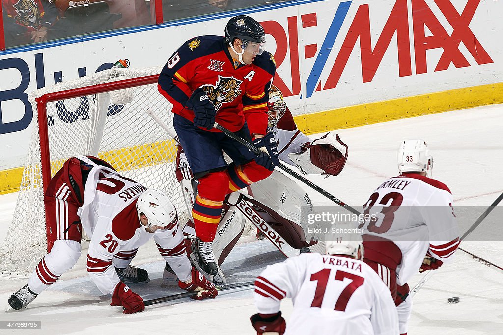 Scottie Upshall #19 of the Florida Panthers jumps while goaltender Mike Smith #41 of the Phoenix Coyotes defends the net at the BB&T Center on March 11, 2014 in Sunrise, Florida.
