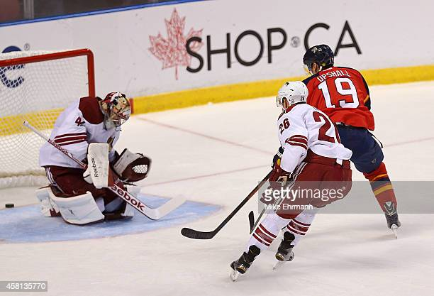 Scottie Upshall of the Florida Panthers scores the go ahead goal during a game against the Arizona Coyotes at BBT Center on October 30 2014 in...