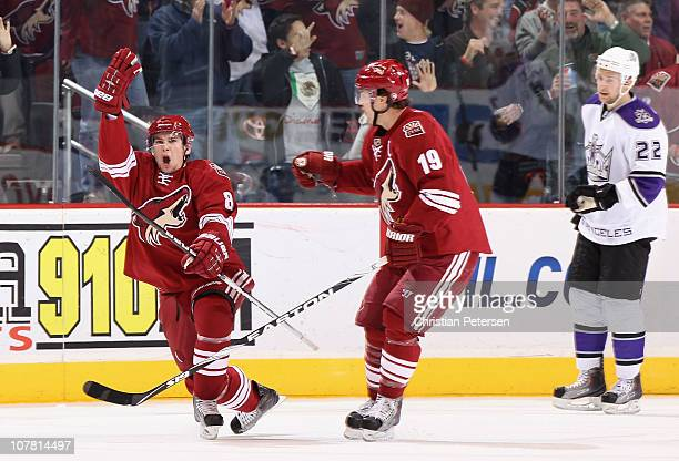 Scottie Upshall of the Phoenix Coyotes celebrates alongside Shane Doan after Upshall socred a first period goal against the Los Angeles Kings during...