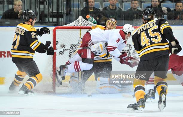 Scottie Upshall of the Phoenix Coyotes crashes into Tuukka Rask of the Boston Bruins at the O2 Arena on October 9 2010 in Prague Czech Republic