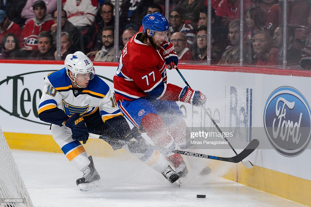 Scottie Upshall #10 of the St. Louis Blues and Tom Gilbert #77 of the Montreal Canadiens skate after the puck during the NHL game at the Bell Centre on October 20, 2015 in Montreal, Quebec, Canada. The Montreal Canadiens defeated the St. Louis Blues 3-0.