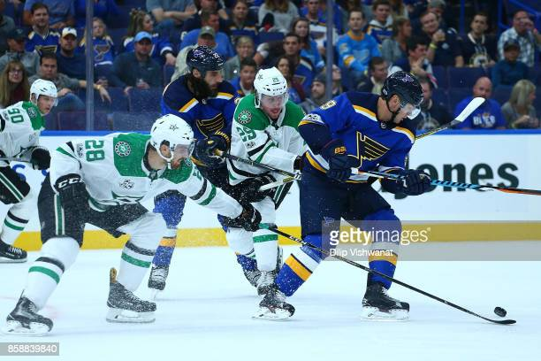 Scottie Upshall of the St Louis Blues looses control of the puck to Greg Pateryn and Stephen Johns of the Dallas Stars in the third period at the...