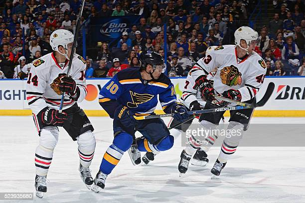 Scottie Upshall of the St Louis Blues skates against Richard Panik and Viktor Svedberg of the Chicago Blackhawks in Game Two of the Western...